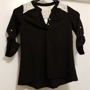 Black blouse with lace. Button up sleeves